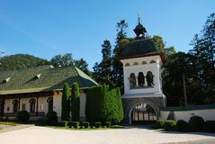 Gate into Sinaia Monastery, Romania. Belltower as a Gate into square of Sinaia Monastery, Romania stock photos
