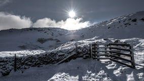 Gate in the snow, Ingleborough stock photo