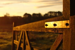 Gate at sunrise Stock Images