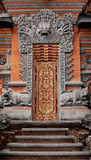 Gate of temple decorated with ornaments. Indonesia, Bali Stock Photography