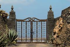 Gate to the cactus garden Stock Photo