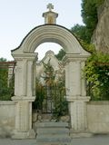 Gate to cemetery. Gate with cross to cemetery Royalty Free Stock Images