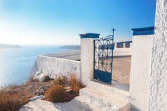 Gate to a church in Fira on Santorini island, Greece. Aegean sea view Royalty Free Stock Images