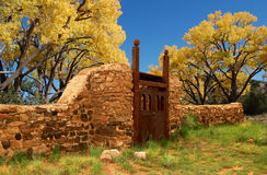 Gate to the Cottonwoods. Stone and wood gate leading to cottonwood trees that are changing into golden fall colors Stock Photography