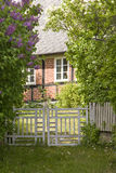 Gate to Cozy House. Gate and pathway into an old, cozy house. Focus is on the gate Royalty Free Stock Images