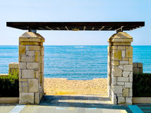Gate to enter the beach against the sea Royalty Free Stock Photography