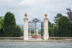 The gate to the garden on the top of te hill. The gate to the garden on the top of te hill on a cloudy day with the panorama of fields, Pannonhalma Abbey, Gyor Royalty Free Stock Photos