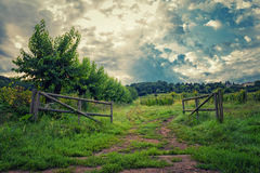 The gate to the hill. Under clouds sky Royalty Free Stock Photography
