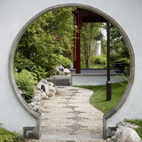 Gate to Japanese garden. Round gate to Japanese garden Royalty Free Stock Photo