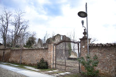 A gate to nowhere. Ancient ruins, walls, gates, streetlight in Montebello della Battaglia, Italy Royalty Free Stock Photography
