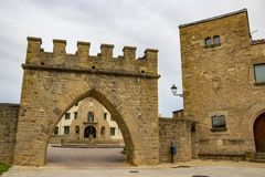 Gate to Plaza de los Fueros, or Los Fueros Square in Obanos, Navarre, Spain on an overcast May day. Old gate to Plaza de los Fueros, or Los Fueros Square in royalty free stock photo