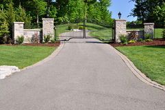Gate to private estate. Impressive wrought iron gate with masonry columns leading to a private estate Royalty Free Stock Photos