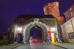 Gate to the Royal Wawel Castle in Krakow at night. Poland Royalty Free Stock Image