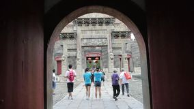 Through gate to see sculpture of ancient arch.China visitors & tourists. Gh2_02867 stock footage