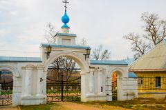Gate to the temple.The Orthodox Church with blue domes in Russia. Stock Photos