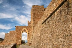 Gate to the town and Montalcino Fortress wall in Val d`Orcia, Tu Stock Photo
