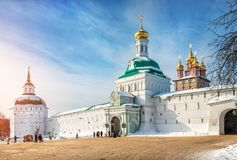 The gate tower above the entrance to the Lavra. The gate tower above the arch of the entrance to the Lavra in Sergiev Posad, the Baptist Church and Pyatnitskaya Stock Image