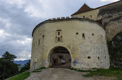 Gate tower of medieval fortress in Rasnov with mountains at back Royalty Free Stock Photography