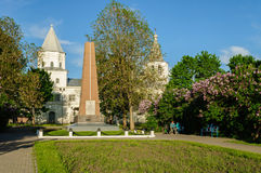 Gate tower of Yaroslav's courtyard  and the monument to war heroes in Veliky Novgorod, Russia Royalty Free Stock Image