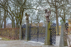 Gate with two statues of the cupid Royalty Free Stock Image