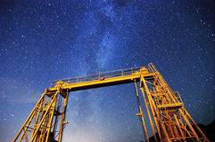 The gate of an unused ferry terminal with the Milky Way in the background Royalty Free Stock Photography