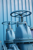 Gate Valves. Detail of large manually-operated gate valves on an industrial plant Royalty Free Stock Photos