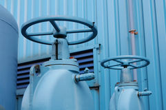 Gate Valves. Large manually operated gate valves on a compressed air system. Short DOF __ focus on near valve Stock Images