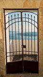 Gate with a view at blue sea and volcano, Imerovigli village, Santorini island Stock Image