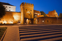 Gate and Wall to Old Town of Torun by Night Royalty Free Stock Images