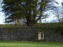 Gate in wall of walled estate. A gate in the opening of a wall in a private walled estate Stock Photo