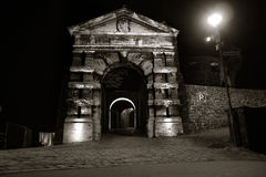Gate Way. Entrance gate to the city castle in Altena, Germany, at night (location of the first youth hostel in the world). Quadtoned image, accentuating contrast Royalty Free Stock Photos