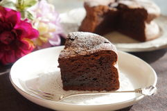 Gateau au Chocolat. Chocolate cake, on a plate Royalty Free Stock Image