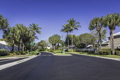Gated community road in tropics Royalty Free Stock Photography