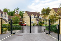 Gated Community. View of a Driveway and Entrance of an Upscale Gated Community Residential Housing Estate stock photography