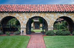 Gated courtyard garden. Arched, gated entrance to courtyard garden Stock Image