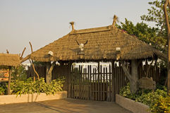 Gated entrance with thatch roof Stock Image
