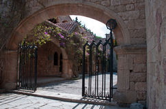 Gated entrance to Courtyard at Ialyssos Monastery Rhodes Stock Image