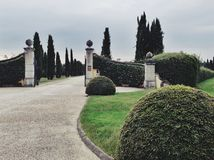 Gated entry to luxury villa Stock Photos