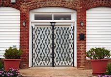 Gated French doors. French doors guarded by a locked security gate royalty free stock photo