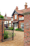 Gated manor house. Photo of a gated manor house with shingle driveway Stock Images
