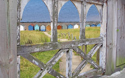 Gated path to beach huts Royalty Free Stock Photos