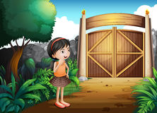 A gated yard with a young girl Stock Photos