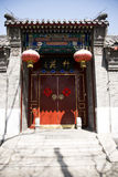 A gatehouse. Beijing traditional Chinese antique architectural style of the gatehouse, red lanterns, red poetic couplet, a red door Stock Photography