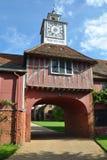 Gatehouse isabelino y reloj Fotografía de archivo libre de regalías