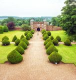 Burton Agnes Hall Gatehouse, Yorkshire, England. The gatehouse and perimeter walls as seen from the magnificent Elizabethan Burton Agnes Hall. This stately home stock photo