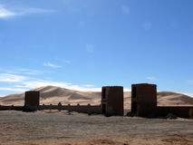 Gatehouses and Wall Before Sahara Dunes Royalty Free Stock Images