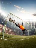 Gatekeeper children soccer player in action. Stadium royalty free stock image