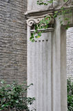 Gatepost made in stone with exquisite engrave. And plant, of aged architecture, shown as traditional and fine architecture style and element of the construction Royalty Free Stock Images