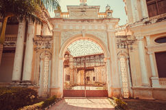 Gates with arch of colonial stule building in Mysore of Karnataka, India. Royalty Free Stock Images
