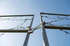 The gates of the border are locked and wound with barbed wire royalty free stock photos